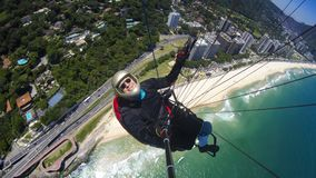 Poor physical piloting your own paraglider. Flying in Rio de Janeiro, Brazil South America Stock Images