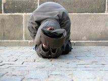 Poor Praga Man. A poor man in Praga on the road Royalty Free Stock Photo