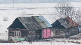 Poor Roma family home at wintertime. royalty free stock photo