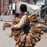 A poor salesperson in the street. A salesman in front of the Delhi gate Lahore stock photography