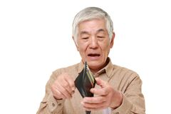 Poor senior Japanese man. Portrait of senior Japanese man on white background royalty free stock images