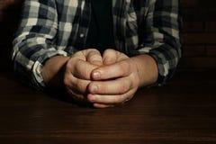 Poor senior man sitting at table. Closeup stock images