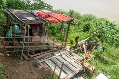 A poor shack on the banks of the Mekong River. In Luang Prabang, Laos stock photography