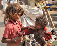 Poor siblings in the streets of Jaipur. Royalty Free Stock Photos