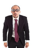 Poor Sight Businessman staring. A businessman wearing thick, circle glasses Stock Photography
