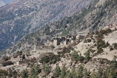 Village on steep hill in Himalaya stock photos
