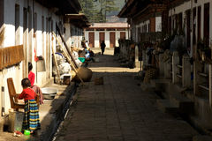 Poor street in the Dochuia dis. A poor stret in dochuia with people doing their daily tasks royalty free stock photo