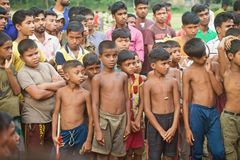 Poor village children standing together isolated unique photo. Bangladeshi children standing together around a place unique editorial photograph stock photos