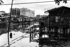 Poor Village Poverty Stricken Stilts Above Sea Ocean Low Tide Slum In Disrepair stock images