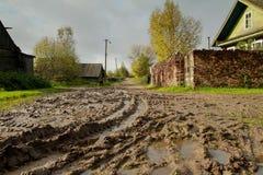 Poor village street in Vepsskaya hills. Royalty Free Stock Photography