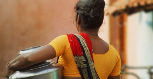 Poor Village woman carrying water pots in South India Royalty Free Stock Photos