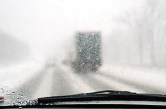 Hazardous driving. Poor visibility through a windshield during a snow storm Stock Image