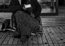 Poor woman alms. Poor woman begging in supermarket, eviction and injustice money alms old hand person social background poverty asking silver rich crisis income royalty free stock image