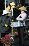 A poor woman in busy market in Vietnam Royalty Free Stock Photos