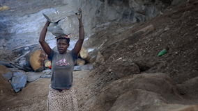 Poor Woman carrying rock in Africa stock video footage