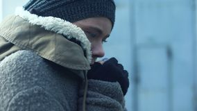 Poor woman in dirty clothes feeling cold, homeless lifestyle, hopelessness. Stock footage stock video