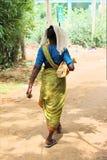 Poor woman walking Stock Images