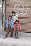 Poor young children in India. LEH, INDIA - JUNE 29, 2015: Unidentified poor Indian beggar children on street in Ladakh. Children of the early ages are often Royalty Free Stock Image