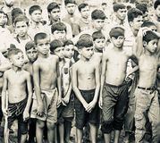 Bangladeshi group of children standing in a place unique photo. Poor young children standing together around a place isolated unique black and white photo stock photography
