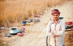 A young farmer standing around an agricultural field royalty free stock images