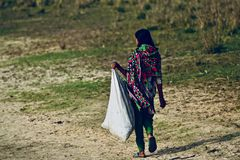 Young village lady is carrying a bag stock photograph royalty free stock images