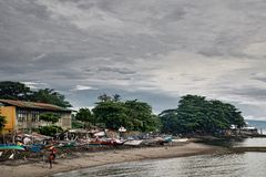 A Asian fishing village scene cloudy sky. stock photo