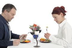 Poorly. Couple and a bad lousy poorly dinner Royalty Free Stock Images
