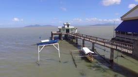 Poorly built religious shrine, long span bridge built in the middle of lake. San Antonio, Bay, Laguna, Philippines - February 23, 2018: Poorly built religious stock video