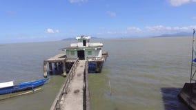 Poorly built religious shrine, long span bridge built in the middle of lake. San Antonio, Bay, Laguna, Philippines - February 23, 2018: Poorly built religious stock footage