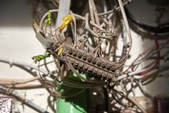 Poorly insulated, dirty ugly wires. Bad electrician Stock Image