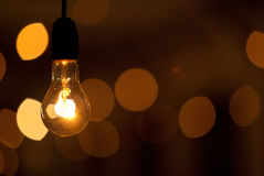 Poorly lit lamp on blurred dark background Stock Images