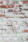 Poorly painted wall of damaged red brick with white paint, textu Royalty Free Stock Images