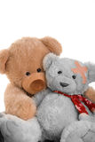Poorly teddy. Two teddybears shot in a portrait hi key style cuddling caring as one is poorly with a bandage Stock Photos