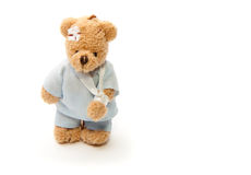 Poorly teddy bear. Injured teddy bear toy isolated on white background Stock Images