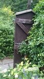 Poort verborgen ommuurde tuin Royalty-vrije Stock Fotografie