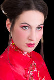 Poortrait of young beautiful geisha over black Royalty Free Stock Photo