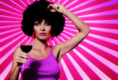 Pop art. Like image of young nice woman with glass of wine on pink back stock photography