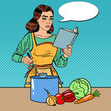 Pop Art Beautiful Housewife Cooking Soup in the Kitchen with Book of Recipes. Vector illustration Stock Image