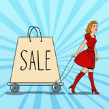 Pop Art Beautiful Woman with Giant Shopping Bag on Sale Royalty Free Stock Images