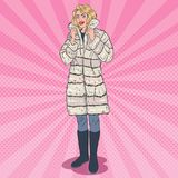 Pop Art Beautiful Woman Posing in Warm Fur Coat. Girl in Winter Clothes. Vector illustration Royalty Free Stock Images
