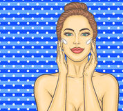 Pop art beautiful young woman makes a face massage Royalty Free Stock Photo