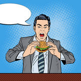 Pop Art Business Man Eating Tasty Burger at Work. Vector illustration Royalty Free Stock Photos