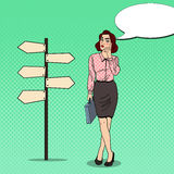 Pop Art Business Woman on Crossroads Pointer Sign. Pop Art Doubtful Business Woman on Crossroads Pointer Sign. Vector illustration Royalty Free Stock Photos