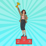 Pop Art Business Woman Standing on Podium. First Place with Golden Cup. Vector illustration Royalty Free Stock Photo
