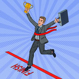 Pop Art Businessman with Golden Winner Cup Crossing Finish Line. Vector illustration Stock Photos