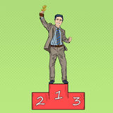 Pop Art Businessman Holding Golden Winners Cup. Pop Art Happy Businessman Holding Golden Winners Cup on First Place Podium. Vector illustration Stock Photos