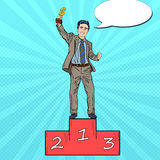Pop Art Businessman Holding Golden Winners Cup. Pop Art Happy Businessman Holding Golden Winners Cup on First Place Podium. Vector illustration Royalty Free Stock Photo