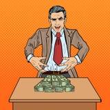 Pop Art Businessman Wants som griper pengarna Arkivfoto
