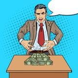 Pop Art Businessman Wants to Seize the Money Stock Image