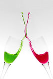 Pop Art Celebration. Two champagne glasses clinking and mixing liquids stock images